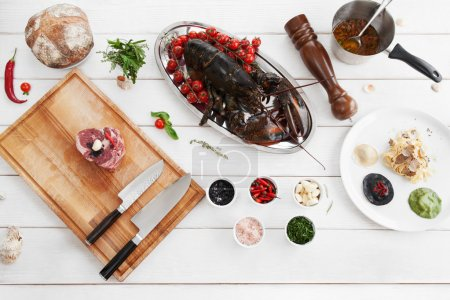Photo for Ingredients for cooking, raw food, flat lay. Top view on products, prepared for making mediterranean meal, white wooden background. Italian cuisine, culinary classes, restaurant kitchen concept - Royalty Free Image