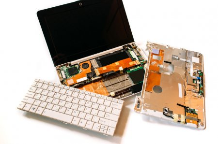 Disassembled broken netbook (laptop). The isolated...
