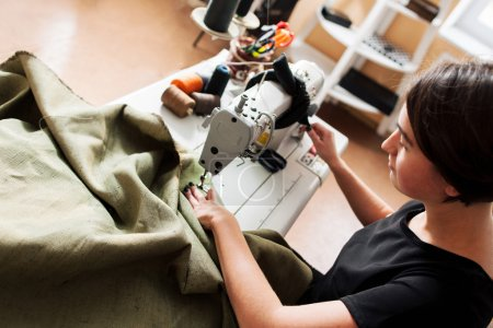 seamstress sews clothes. Workplace of tailor