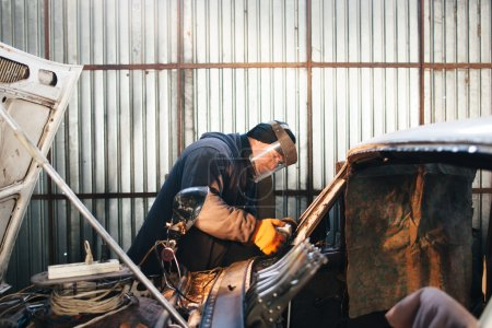 Renovation of old damaged car in Russia