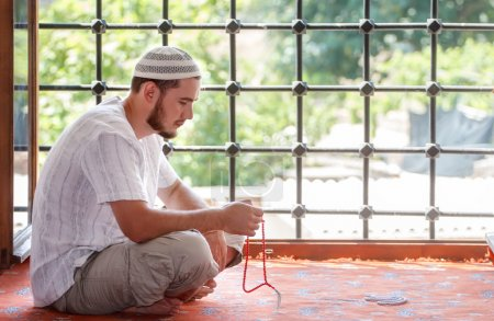 Bearded man praying in the mosque