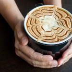 Hot Coffee in female hand