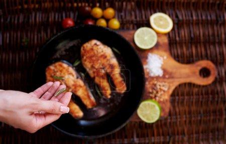 the cook Sprinkle steaks  fish seasoning