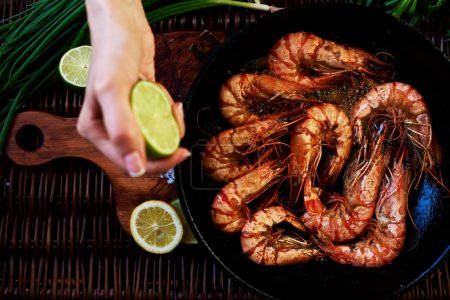 Girl chef squeezes out lime shrimp