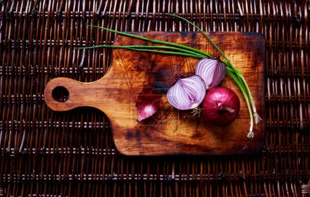 There are fresh vegetables on the table rattan