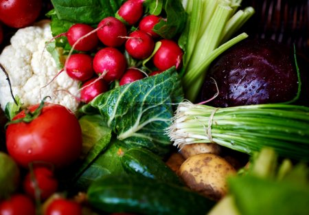 There are Assorted fresh vegetables on the table rattan