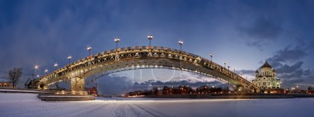 Evening winter view of the Patriarchal bridge from the ice of the Moskva River