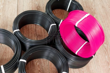 set of black and pink electric cables