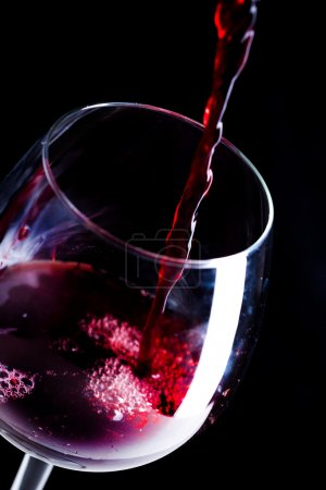 red wine pouring in wineglass