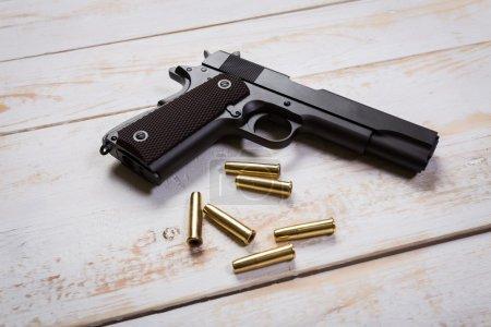 hand gun with bullets on desks
