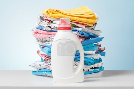 Colorful towels and liquid laundry detergent