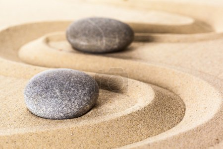 Two stones on sand