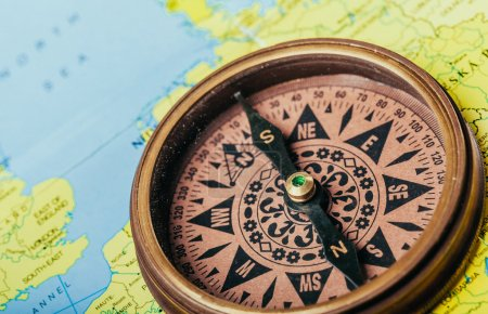 compass on the geographic map