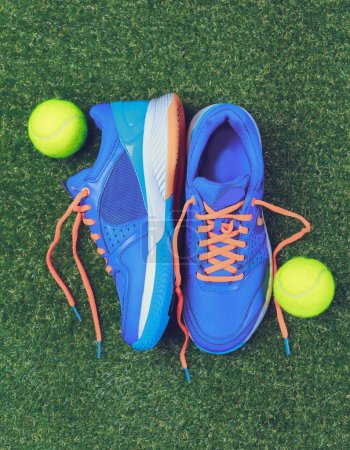 Sport background: blue running shoes and tennis ob...