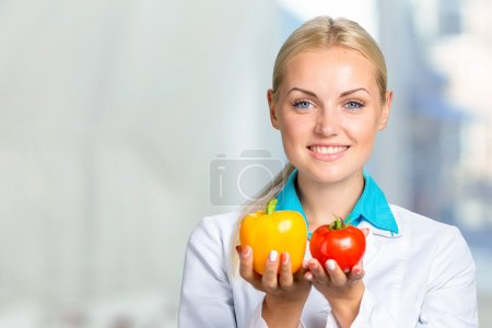 Happy Female Dietician With Fresh Vegetables