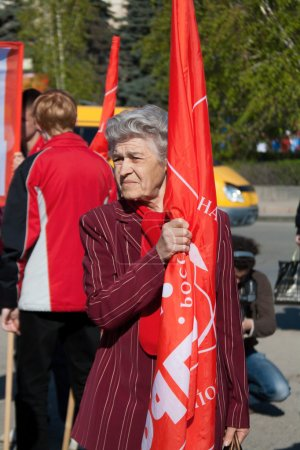 Volgograd, Russia - May 1, 2011:Woman with flag takes part in the May day demonstration in Volgograd