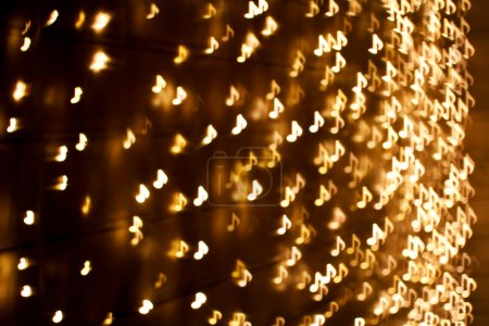 Blurring lights bokeh background of music notes