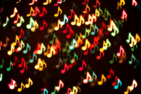 Blurring lights bokeh background of colorful music notes