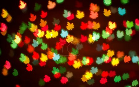 Blurring lights bokeh background of colorful leaves