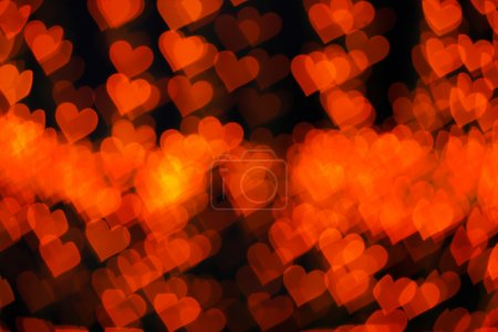 Blurring lights bokeh background of red hearts