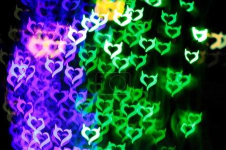Blurring lights bokeh background of Devil hearts