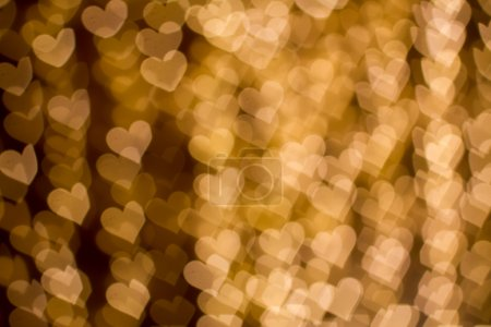 Blurring lights bokeh background of hearts