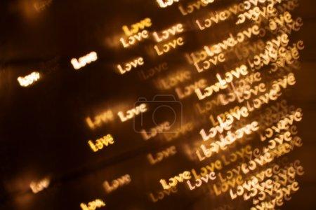 Blurring lights bokeh background of words LOVE