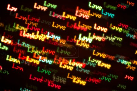 Blurring lights bokeh background of colorful words LOVE
