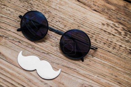 sunglasses andwhite paper mustache