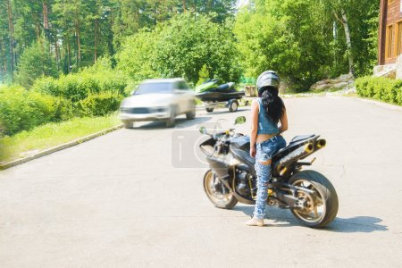 brunette woman sit on sports motorcycle