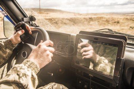 Soldier  inside brutal SUV