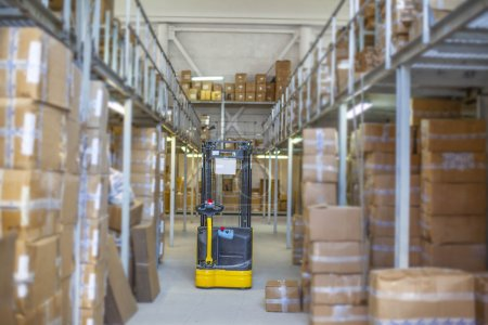yellow forklift in big warehouse
