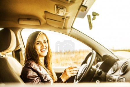 young woman in car  turning
