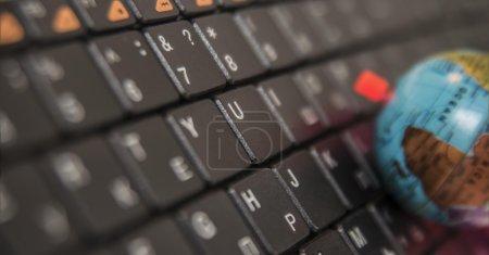 small globe on a keyboard
