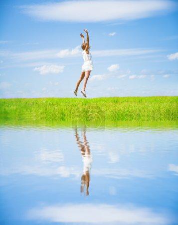 Woman Jumping in  green field