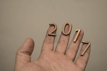 Hand Holding wooden number