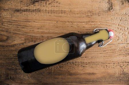 opened  dark brown beer bottle