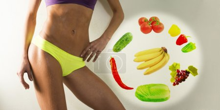 slim woman with vegetables