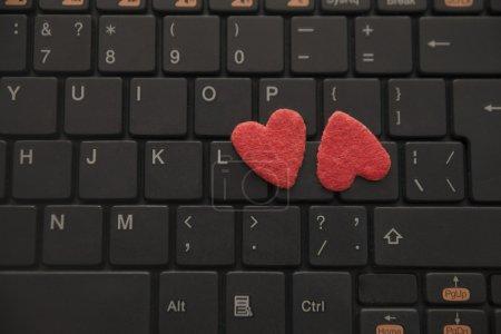 Hearts on black computer keyboard