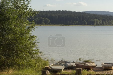Small fisherman boats on lake Lipno in south Bohemia, Czech Repu