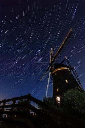 Startrails above an old Dutch windmill