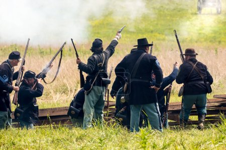 Soldiers battle during the reenactment of the Civil War