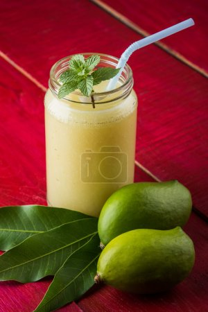Green mango juice also known as kairi panha, aam panna, Mango Pahna, green mango drink, Fresh green mango smoothie with fresh green mangos
