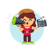 Movie director girl in directors hat standing
