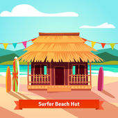 Surfers lagoon beach hut with surfboards