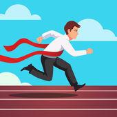 Running businessman crosses finish line