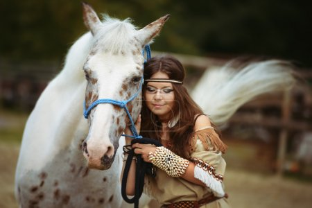 Young Indian girl walk with white horse lovely