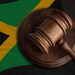 Judge gavel and flag of Jamaica. Law and justice i...