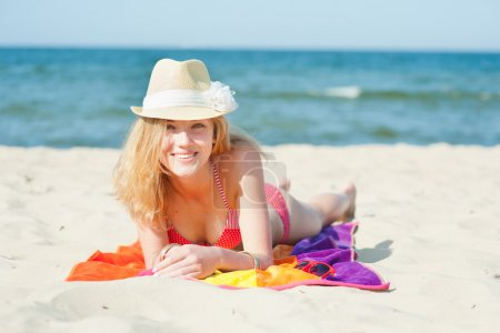 Beautiful young woman on a beach - summer portrait