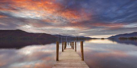 Flooded jetty in Derwent Water, Lake District, England at sunset